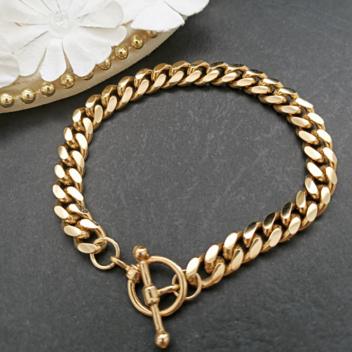 B-33d 7mm Curb Link 14K Gold Layered bracelet FOB CLASP